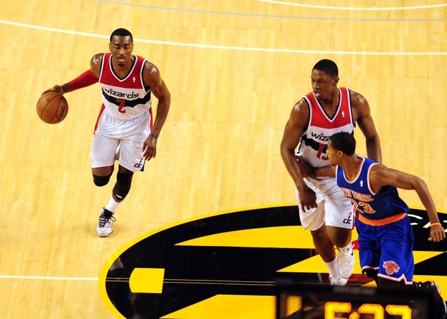 Oct 17, 2013; Baltimore, MD, USA; Washington Wizards guard John Wall (2) dribbles up court against the New York Knicks at Baltimore Arena. Mandatory Credit: Evan Habeeb-USA TODAY Sports