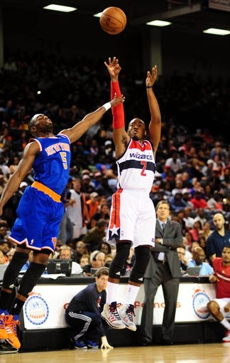 Oct 17, 2013; Baltimore, MD, USA; Washington Wizards guard John Wall (2) shoots the ball over New York Knicks guard Tim Hardaway Jr. (5) at Baltimore Arena. Mandatory Credit: Evan Habeeb-USA TODAY Sports