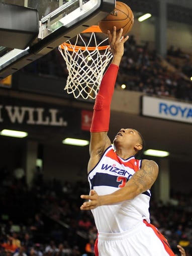 Oct 17, 2013; Baltimore, MD, USA; Washington Wizards guard Bradley Beal (3) lays the ball up during the game against the New York Knicks at Baltimore Arena. Mandatory Credit: Evan Habeeb-USA TODAY Sports