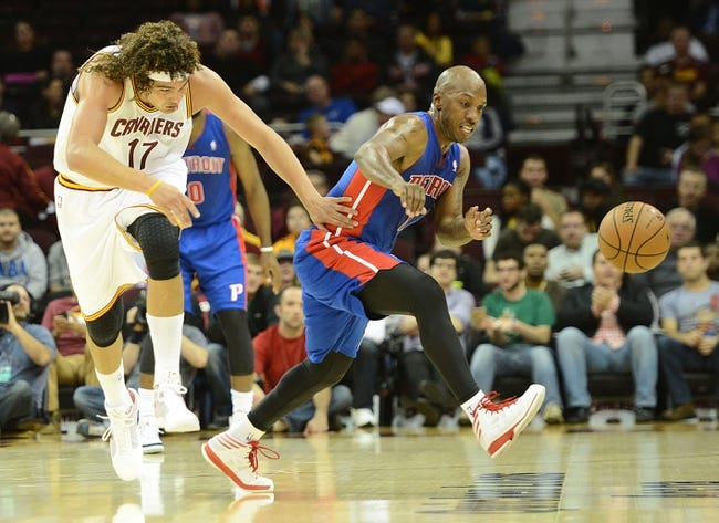 Oct 17, 2013; Cleveland, OH, USA; Cleveland Cavaliers power forward Anderson Varejao (17) and Detroit Pistons point guard Chauncey Billups (1) go for a loose ball during the game at Quicken Loans Arena. Mandatory Credit: Eric P. Mull-USA TODAY Sports
