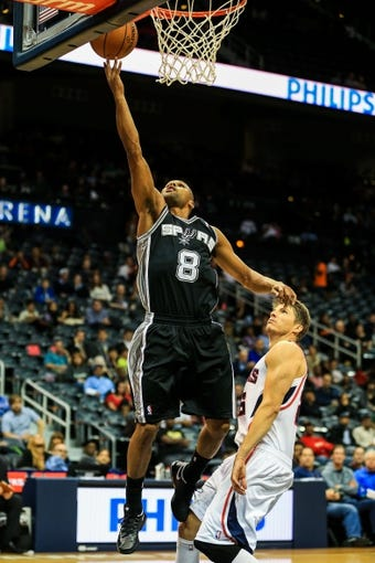 Oct 17, 2013; Atlanta, GA, USA; San Antonio Spurs point guard Patty Mills (8) shoots a lay up in the second half against the Atlanta Hawks at Philips Arena. The Spurs won 106-104. Mandatory Credit: Daniel Shirey-USA TODAY Sports