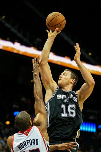 Oct 17, 2013; Atlanta, GA, USA; San Antonio Spurs power forward Aron Baynes (16) shoots a basket over Atlanta Hawks power forward Al Horford (15) in the second half at Philips Arena. The Spurs won 106-104. Mandatory Credit: Daniel Shirey-USA TODAY Sports