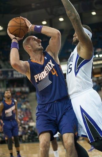 Oct 17, 2013; Sacramento, CA, USA; Phoenix Suns center Marcin Gortat (4) attempts a shot against Sacramento Kings center DeMarcus Cousins (15) during the first quarter at Sleep Train Arena. Mandatory Credit: Ed Szczepanski-USA TODAY Sports