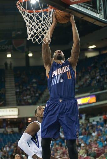 Oct 17, 2013; Sacramento, CA, USA; Phoenix Suns power forward Markieff Morris (11) scores against the Sacramento Kings during the first quarter at Sleep Train Arena. Mandatory Credit: Ed Szczepanski-USA TODAY Sports