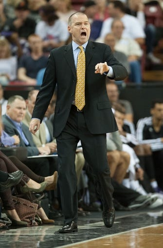 Oct 17, 2013; Sacramento, CA, USA; Sacramento Kings head coach Michael Malone directs his team during the second quarter of the game against the Phoenix Suns at Sleep Train Arena. Mandatory Credit: Ed Szczepanski-USA TODAY Sports