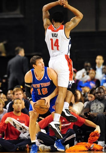 Oct 17, 2013; Baltimore, MD, USA; New York Knicks guard Beno Udrih (18) is defended by Washington Wizards guard Glen Rice (14) at Baltimore Arena. Mandatory Credit: Evan Habeeb-USA TODAY Sports
