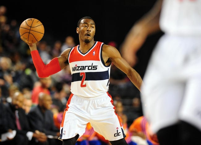 Oct 17, 2013; Baltimore, MD, USA; Washington Wizards guard John Wall (2) passes the ball during the game against the New York Knicks at Baltimore Arena. Mandatory Credit: Evan Habeeb-USA TODAY Sports