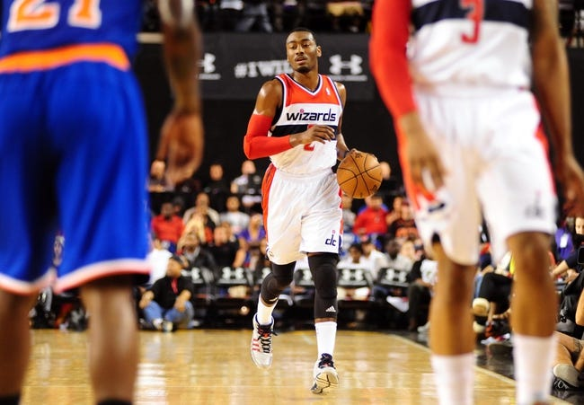 Oct 17, 2013; Baltimore, MD, USA; Washington Wizards guard John Wall (2) dribbles the ball up court during the game against the New York Knicks at Baltimore Arena. Mandatory Credit: Evan Habeeb-USA TODAY Sports