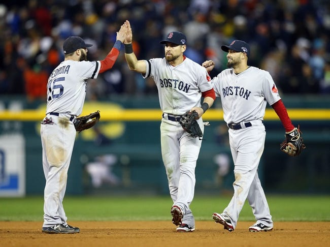 Oct 17, 2013; Detroit, MI, USA; Boston Red Sox second baseman Dustin Pedroia (15), center fielder Jacoby Ellsbury (center), and right fielder Shane Victorino (right) celebrate defeating the Detroit Tigers in game five of the American League Championship Series baseball game at Comerica Park. Boston won 4-3. Mandatory Credit: Rick Osentoski-USA TODAY Sports