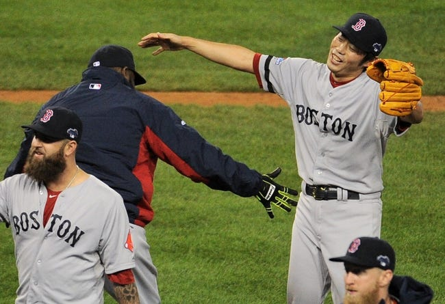 Oct 17, 2013; Detroit, MI, USA; Boston Red Sox relief pitcher Koji Uehara (19) celebrates with designated hitter David Ortiz (left) after defeating the Detroit Tigers in game five of the American League Championship Series baseball game at Comerica Park. Boston won 4-3. Mandatory Credit: Tim Fuller-USA TODAY Sports
