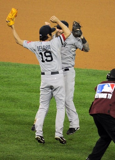 Oct 17, 2013; Detroit, MI, USA; Boston Red Sox relief pitcher Koji Uehara (19) celebrates with first baseman Mike Napoli (12) after defeating the Detroit Tigers in game five of the American League Championship Series baseball game at Comerica Park. Boston won 4-3. Mandatory Credit: Tim Fuller-USA TODAY Sports