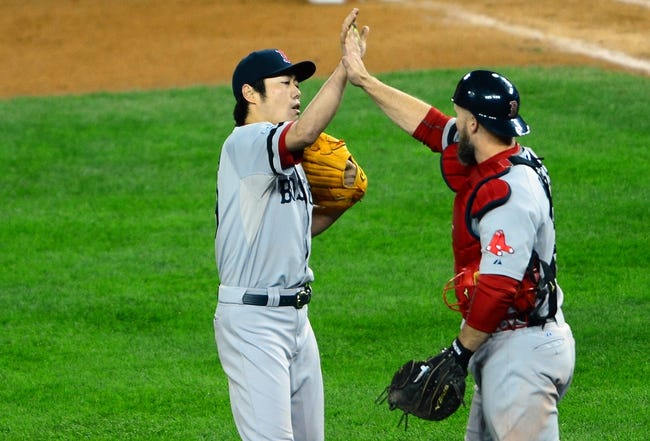 Oct 17, 2013; Detroit, MI, USA; Boston Red Sox relief pitcher Koji Uehara (19) celebrates with catcher David Ross (3) after defeating the Detroit Tigers in game five of the American League Championship Series baseball game at Comerica Park. Boston won 4-3. Mandatory Credit: Andrew Weber-USA TODAY Sports