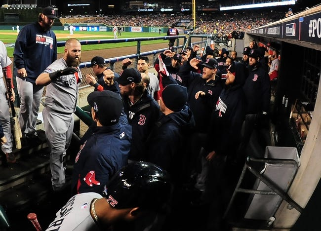 Oct 17, 2013; Detroit, MI, USA; Boston Red Sox first baseman Mike Napoli (left) celebrates with teammates after scoring against the Detroit Tigers during the second inning in game five of the American League Championship Series baseball game at Comerica Park. Boston won 4-3. Mandatory Credit: Andrew Weber-USA TODAY Sports