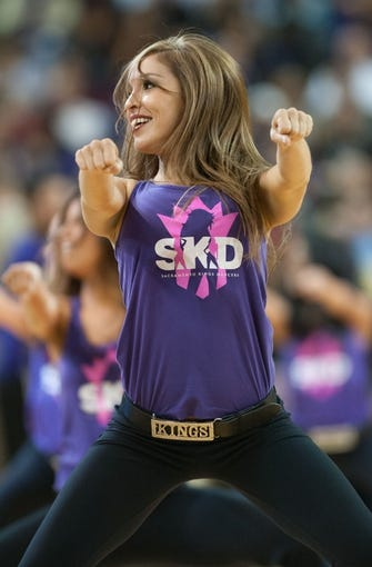Oct 17, 2013; Sacramento, CA, USA; A Sacramento Kings dancer performs during a time out in the game between the Sacramento Kings and Phoenix Suns at Sleep Train Arena. The Sacramento Kings defeated the Phoenix Suns 107-90 Mandatory Credit: Ed Szczepanski-USA TODAY Sports