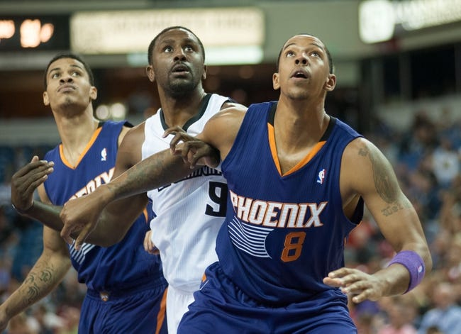 Oct 17, 2013; Sacramento, CA, USA; Phoenix Suns power forward Channing Frye (8) fights for position with Sacramento Kings power forward Patrick Patterson (9) during the fourth quarter at Sleep Train Arena. The Sacramento Kings defeated the Phoenix Suns 107-90 Mandatory Credit: Ed Szczepanski-USA TODAY Sports