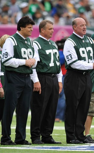 Oct 13, 2013; East Rutherford, NJ, USA; New York Jets former players Mark Gastineau (99) and Joe Klecko (73) and Marty Lyons serve as honorary captains during the coin toss before the New York Jets faced the Pittsburgh Steelers at MetLife Stadium. The Steelers won the game 19-6. Mandatory Credit: Joe Camporeale-USA TODAY Sports