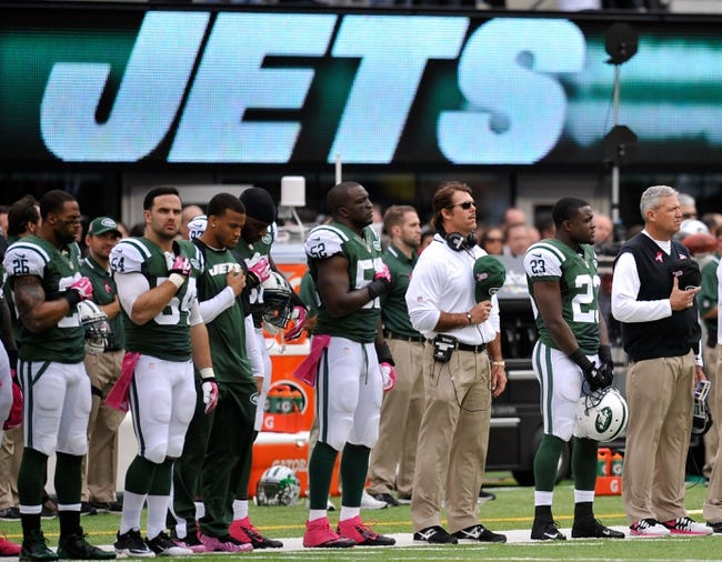 Oct 13, 2013; East Rutherford, NJ, USA; New York Jets head coach Rex Ryan (pictured right) and members of his team look on during the national anthem before facing the Pittsburgh Steelers at MetLife Stadium. The Steelers won the game 19-6. Mandatory Credit: Joe Camporeale-USA TODAY Sports