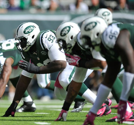 Oct 13, 2013; East Rutherford, NJ, USA; New York Jets defensive tackle Kenrick Ellis (93) lines up for a play against the Pittsburgh Steelers at MetLife Stadium. The Steelers won the game 19-6. Mandatory Credit: Joe Camporeale-USA TODAY Sports