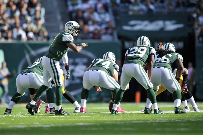Oct 13, 2013; East Rutherford, NJ, USA; New York Jets quarterback Geno Smith (7) calls plays against the Pittsburgh Steelers at MetLife Stadium. The Steelers won the game 19-6. Mandatory Credit: Joe Camporeale-USA TODAY Sports