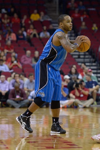 Oct 16, 2013; Houston, TX, USA; Orlando Magic point guard Jameer Nelson (14) passes against the Houston Rockets during the first half at Toyota Center. Mandatory Credit: Thomas Campbell-USA TODAY Sports
