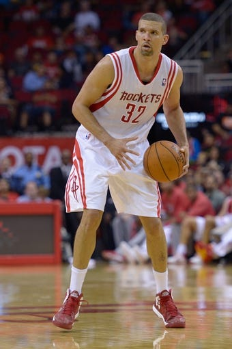 Oct 16, 2013; Houston, TX, USA; Houston Rockets shooting guard Francisco Garcia (32) dribbles against the Orlando Magic during the second half at Toyota Center. The Rockets won 108-104. Mandatory Credit: Thomas Campbell-USA TODAY Sports