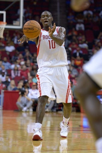 Oct 16, 2013; Houston, TX, USA; Houston Rockets small forward Ronnie Brewer (10) passes against the Orlando Magic during the second half at Toyota Center. The Rockets won 108-104. Mandatory Credit: Thomas Campbell-USA TODAY Sports