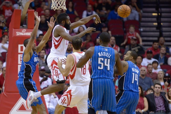 Oct 16, 2013; Houston, TX, USA; Houston Rockets shooting guard James Harden (13) passes against the Orlando Magic during the first half at Toyota Center. Mandatory Credit: Thomas Campbell-USA TODAY Sports