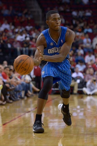 Oct 16, 2013; Houston, TX, USA; Orlando Magic small forward Maurice Harkless (21) passes against the Houston Rockets during the first half at Toyota Center. Mandatory Credit: Thomas Campbell-USA TODAY Sports