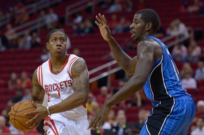 Oct 16, 2013; Houston, TX, USA; Houston Rockets point guard Isaiah Canaan (1) drives against Orlando Magic point guard Jameer Nelson (14) during the second half at Toyota Center. The Rockets won 108-104. Mandatory Credit: Thomas Campbell-USA TODAY Sports