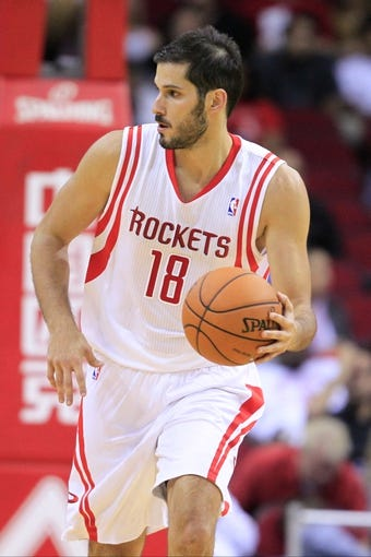 Oct 16, 2013; Houston, TX, USA; Houston Rockets small forward Omri Casspi (18) starts a fast break against the Orlando Magic during the second half at Toyota Center. The Rockets won 108-104. Mandatory Credit: Thomas Campbell-USA TODAY Sports