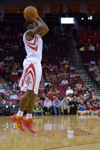 Oct 16, 2013; Houston, TX, USA; Houston Rockets point guard Aaron Brooks (0) shoots against the Orlando Magic during the second half at Toyota Center. The Rockets won 108-104. Mandatory Credit: Thomas Campbell-USA TODAY Sports