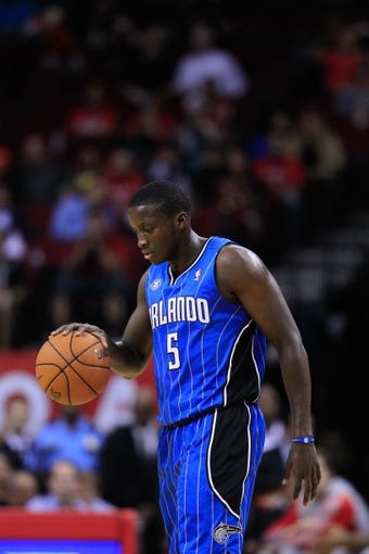 Oct 16, 2013; Houston, TX, USA; Orlando Magic shooting guard Victor Oladipo (5) dribbles against the Houston Rockets during the second half at Toyota Center. The Rockets won 108-104. Mandatory Credit: Thomas Campbell-USA TODAY Sports
