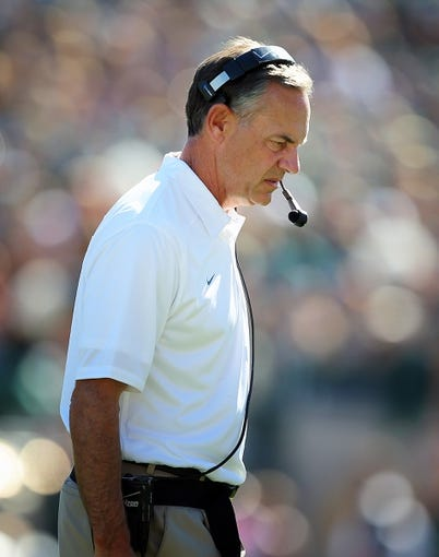 Oct 12, 2013; East Lansing, MI, USA; Michigan State Spartans head coach Mark Dantonio walks the sidelines during the first half in a between the Michigan State Spartans and the Indiana Hoosiers  game at Spartan Stadium. Mandatory Credit: Mike Carter-USA TODAY Sports