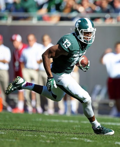 Oct 12, 2013; East Lansing, MI, USA; Michigan State Spartans wide receiver Bennie Fowler (13) runs for yards after the catch against Indiana Hoosiers during the second half in a game at Spartan Stadium. MSU won 42-28. Mandatory Credit: Mike Carter-USA TODAY Sports