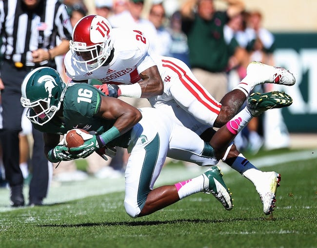 Oct 12, 2013; East Lansing, MI, USA; Michigan State Spartans wide receiver Aaron Burbridge (16) makes a sideline catch against Indiana Hoosiers cornerback Tim Bennett (24) during the first half in a game at Spartan Stadium. Mandatory Credit: Mike Carter-USA TODAY Sports