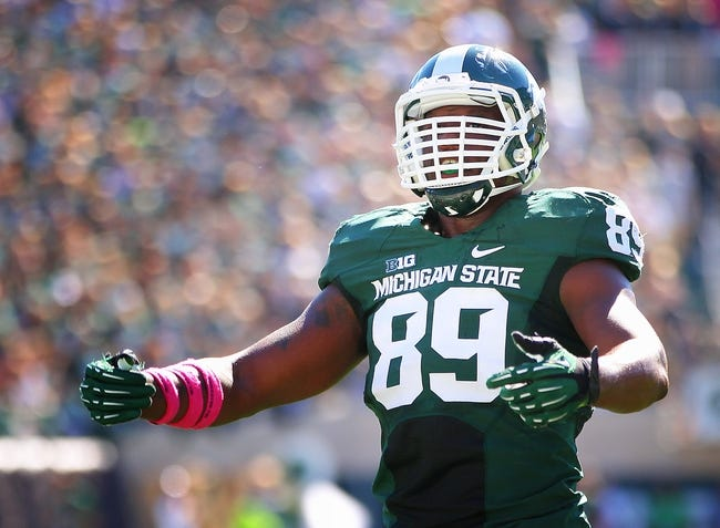Oct 12, 2013; East Lansing, MI, USA; Michigan State Spartans defensive end Shilique Calhoun (89) stands on field in game against Indiana Hoosiers during the first half in a game at Spartan Stadium. Mandatory Credit: Mike Carter-USA TODAY Sports