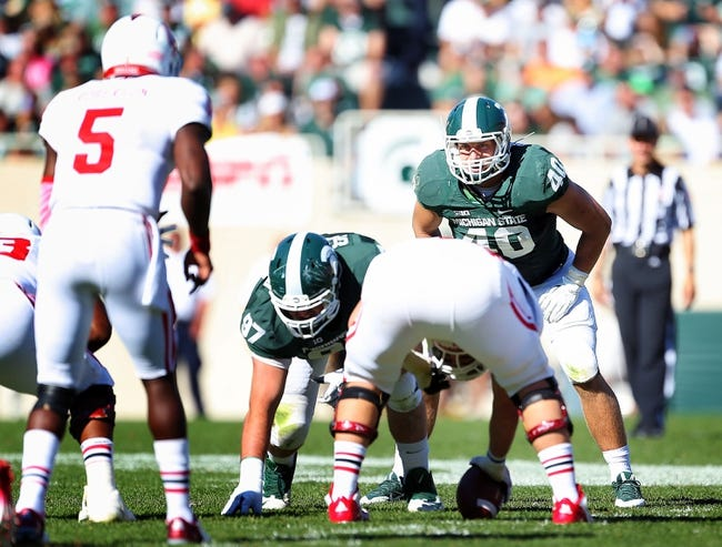 Oct 12, 2013; East Lansing, MI, USA; Michigan State Spartans linebacker Max Bullough (40) looks over Indiana Hoosiers offense during the second half in a game at Spartan Stadium. MSU won 42-28. Mandatory Credit: Mike Carter-USA TODAY Sports