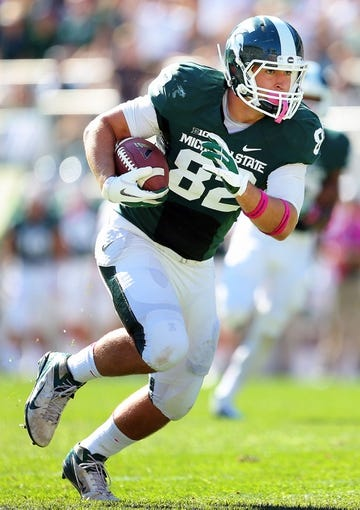 Oct 12, 2013; East Lansing, MI, USA; Michigan State Spartans tight end Josiah Price (82) runs for yards after the catch against Indiana Hoosiers during the first half in a game at Spartan Stadium. Mandatory Credit: Mike Carter-USA TODAY Sports