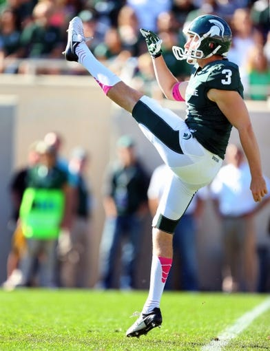 Oct 12, 2013; East Lansing, MI, USA; Michigan State Spartans punter Mike Sadler (3) kicks the ball to Indiana Hoosiers during the second half in a game at Spartan Stadium. MSU won 42-28. Mandatory Credit: Mike Carter-USA TODAY Sports