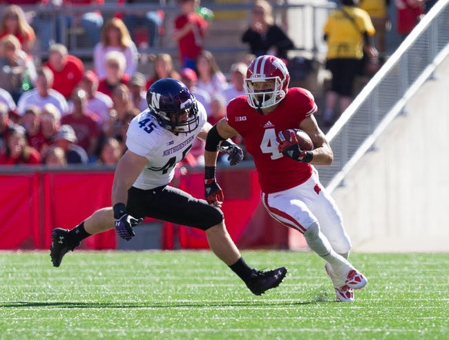 Oct 12, 2013; Madison, WI, USA; Wisconsin Badgers wide receiver Jared Abbrederis (4) during the game against the Northwestern Wildcats at Camp Randall Stadium.  Wisconsin won 35-6.  Mandatory Credit: Jeff Hanisch-USA TODAY Sports