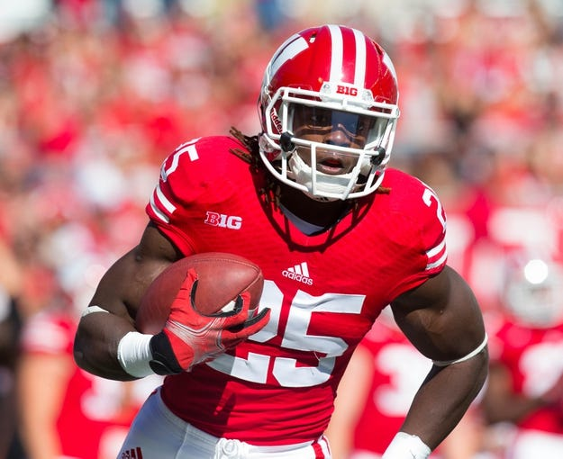 Oct 12, 2013; Madison, WI, USA; Wisconsin Badgers running back Melvin Gordon (25) during warmups prior to the game against the Northwestern Wildcats at Camp Randall Stadium.  Wisconsin won 35-6.  Mandatory Credit: Jeff Hanisch-USA TODAY Sports