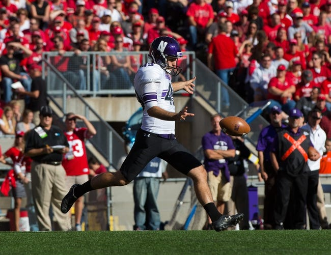 Oct 12, 2013; Madison, WI, USA; Northwestern Wildcats punter Brandon Williams (49) during the game against the Wisconsin Badgers at Camp Randall Stadium.  Wisconsin won 35-6.  Mandatory Credit: Jeff Hanisch-USA TODAY Sports