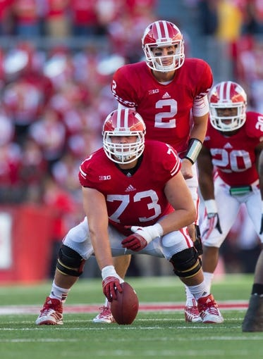 Oct 12, 2013; Madison, WI, USA; Wisconsin Badgers offensive lineman Dallas Lewallen (73) during the game against the Northwestern Wildcats at Camp Randall Stadium.  Wisconsin won 35-6.  Mandatory Credit: Jeff Hanisch-USA TODAY Sports
