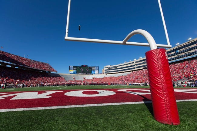 Oct 12, 2013; Madison, WI, USA; Wide angle view of Camp Randall Stadium during the game between the Northwestern Wildcats and Wisconsin Badgers.  Wisconsin won 35-6.  Mandatory Credit: Jeff Hanisch-USA TODAY Sports