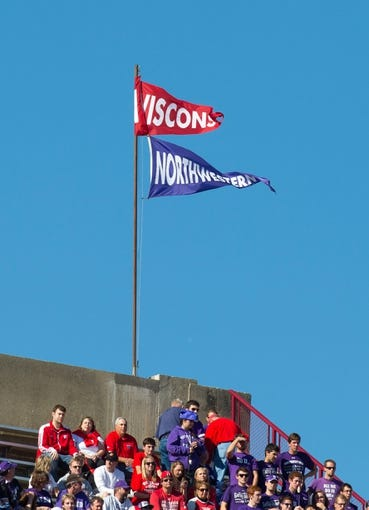 Oct 12, 2013; Madison, WI, USA; Flags for the Northwestern Wildcats and Wisconsin Badgers fly over Camp Randall Stadium.  Wisconsin won 35-6.  Mandatory Credit: Jeff Hanisch-USA TODAY Sports