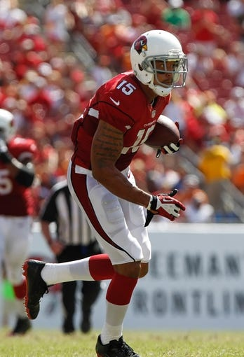 Sep 29, 2013; Tampa, FL, USA; Arizona Cardinals wide receiver Michael Floyd (15) runs with the ball against the Tampa Bay Buccaneers during the second half at Raymond James Stadium. Arizona Cardinals defeated the Tampa Bay Buccaneers 13-10. Mandatory Credit: Kim Klement-USA TODAY Sports
