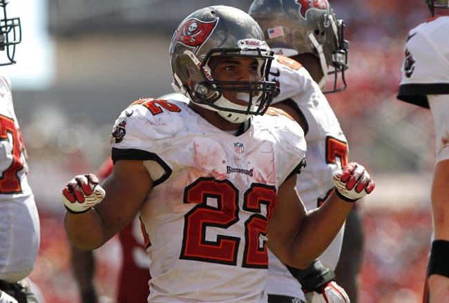 Sep 29, 2013; Tampa, FL, USA; Tampa Bay Buccaneers running back Doug Martin (22) against the Arizona Cardinals during the second half at Raymond James Stadium. Arizona Cardinals defeated the Tampa Bay Buccaneers 13-10. Mandatory Credit: Kim Klement-USA TODAY Sports