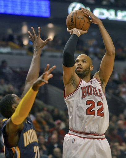 Oct 18, 2013; Chicago, IL, USA; Chicago Bulls forward Taj Gibson shoots against the Indiana Pacers player Ian Mahinmi at the United Center. Mandatory Credit: Matt Marton-USA TODAY Sports