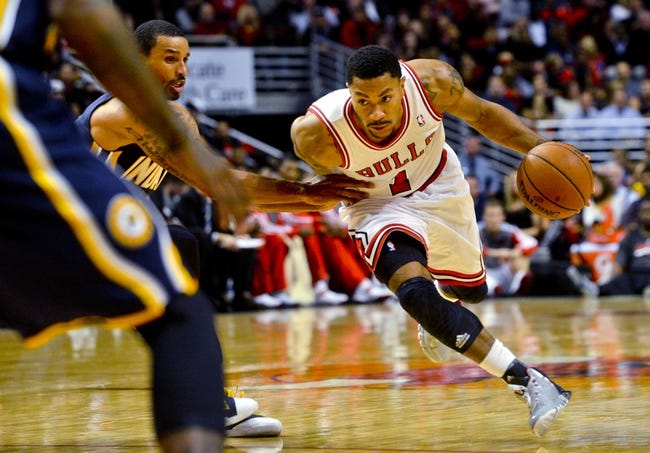 Oct 18, 2013; Chicago, IL, USA; Chicago Bulls guard Derrick Rose dribbles against the Indiana Pacers guard George Hill at the United Center. Mandatory Credit: Matt Marton-USA TODAY Sports