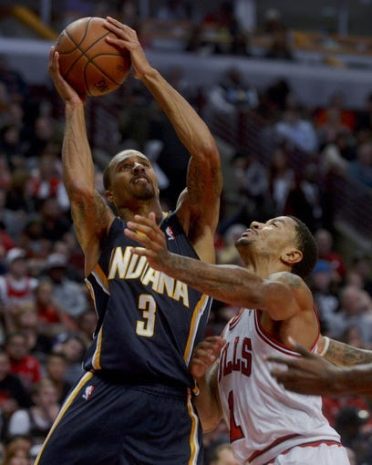 Oct 18, 2013; Chicago, IL, USA; Indiana Pacers guard George Hill shoots against the Chicago Bulls guard Derrick Rose at the United Center. Mandatory Credit: Matt Marton-USA TODAY Sports